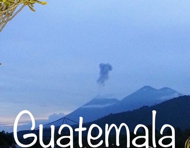 volcano in guatemala antigua erupting poof of smoke